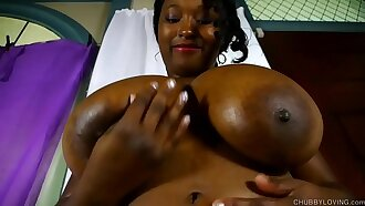 Busty black BBW beauty oils up her nice big tits and fucks her soaking wet pussy