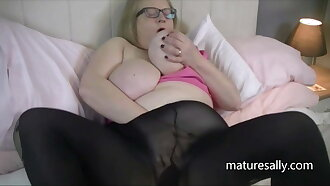 Big titted Sally in black pantyhose
